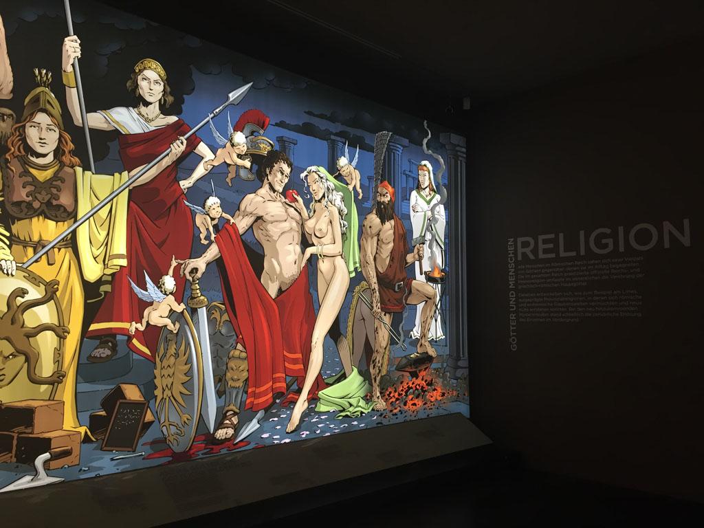 Maureen en ik halen onze kennis over de oude goden op bij deze moderne afbeelding.