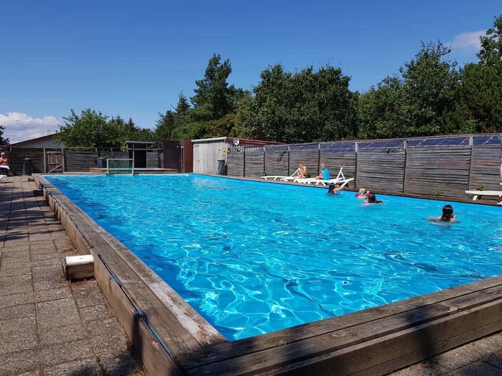 Een lekker verwarmd zwembad,